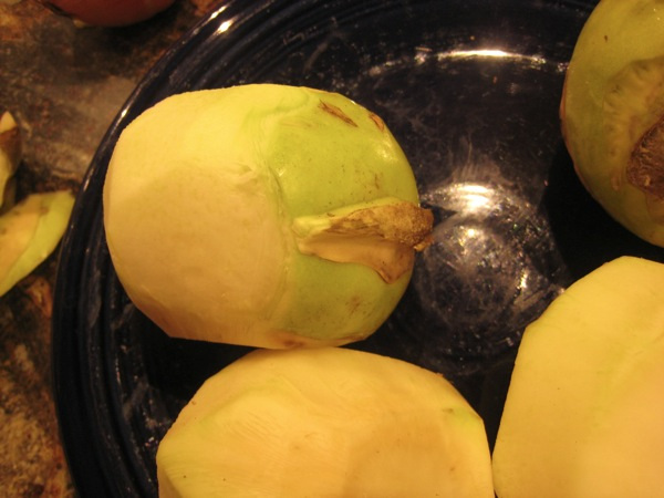 Peeling kohlrabi is easier if you slice off the top and bottom, and peel the sides in strips from top to bottom.